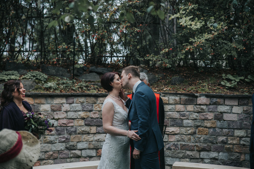 Calgary Garden Wedding Ceremony Bride and groom kissing