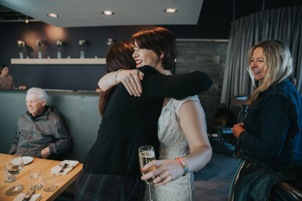 Bride hugging wedding guest at Cassis Bistro