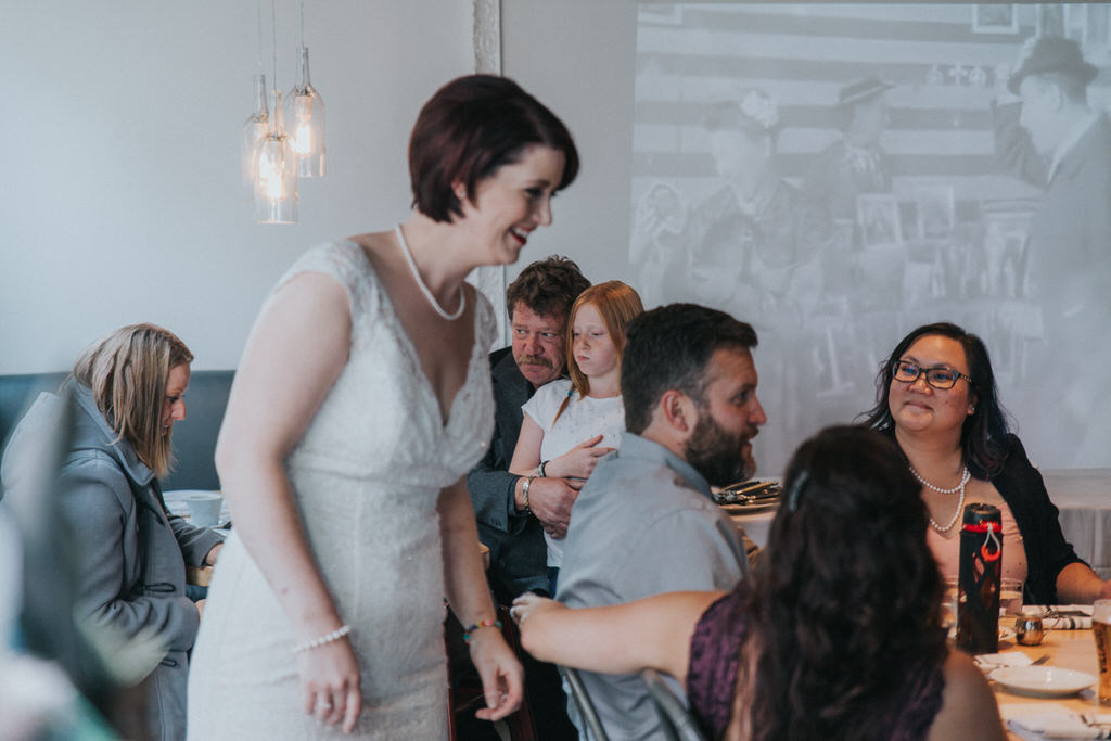Bride laughing with wedding guest at Cassis Bistro