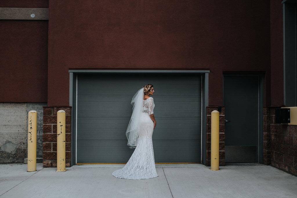 Calgary Wedding Editorial Portrait of Bride against garage door