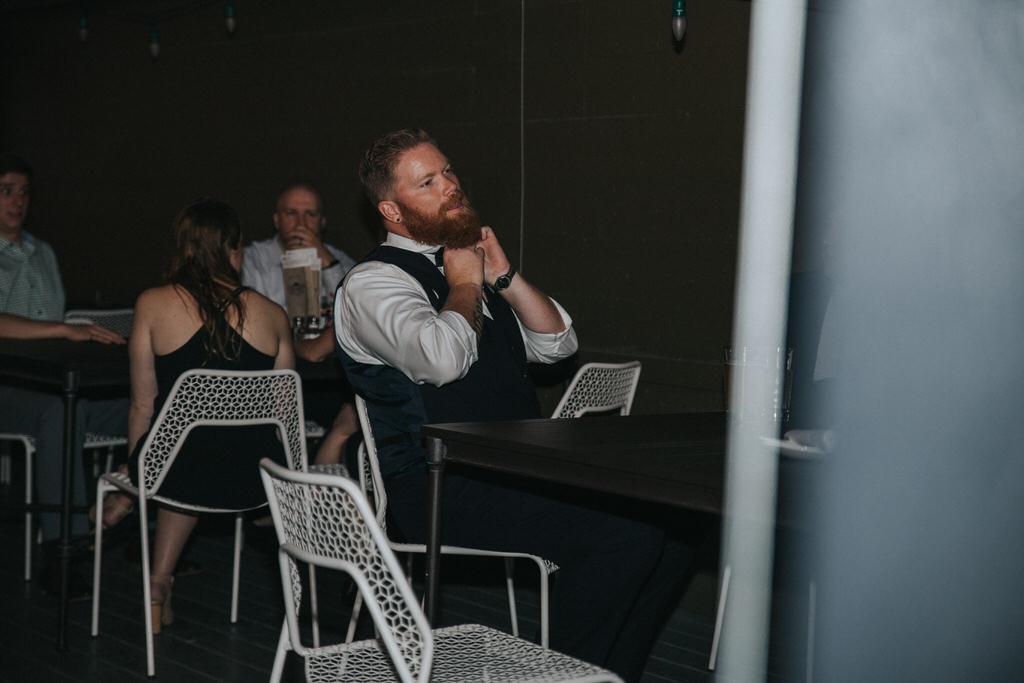 Calgary wedding photography Groom taking off bowtie