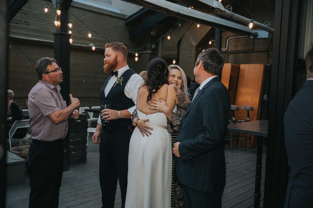 Calgary Wedding Photographer Bride and groom with wedding guests