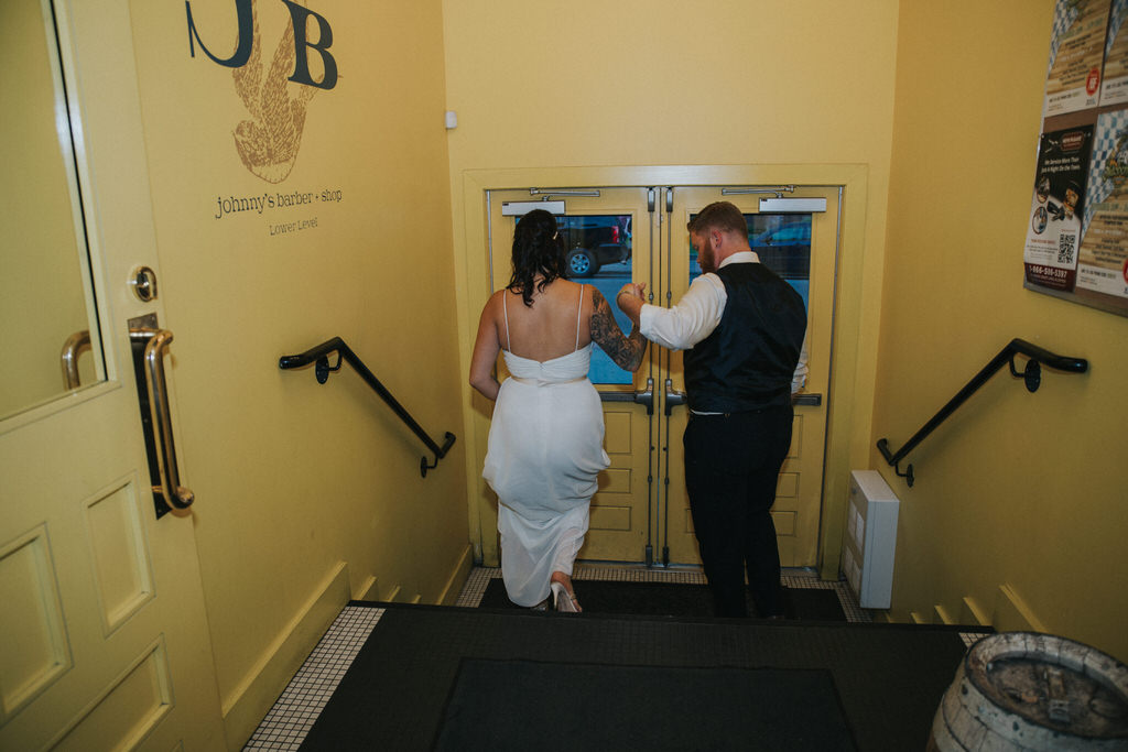 Bride and Groom walking out of building