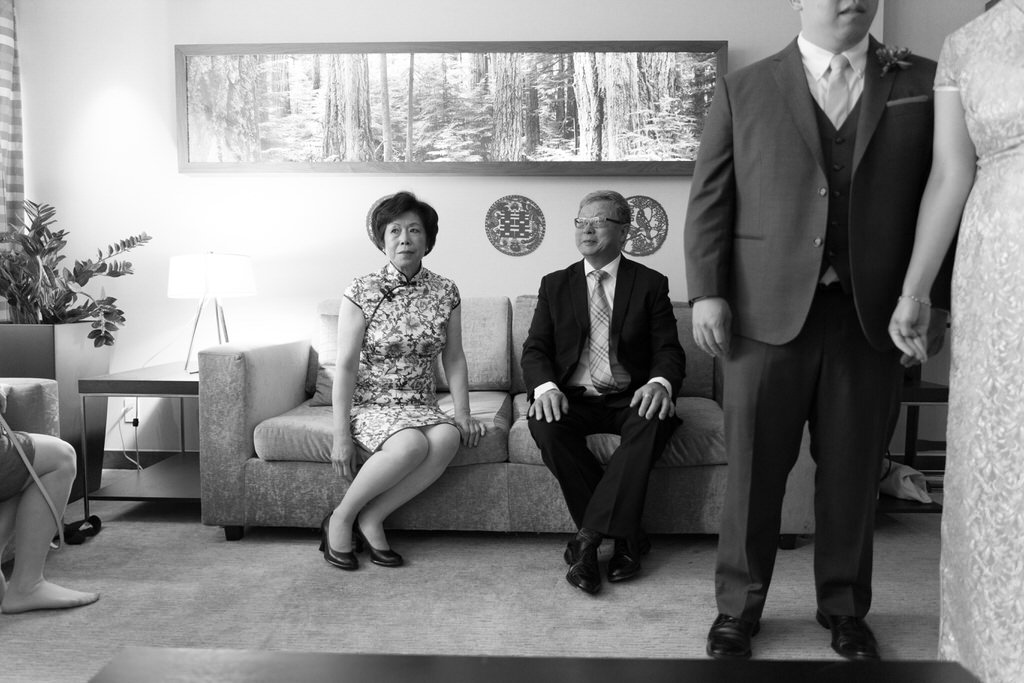 Asian Parents waiting on sofa for Chinese Tea Ceremony