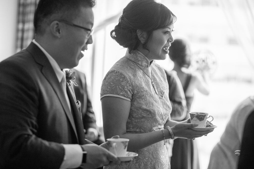 Chinese Wedding Tea Ceremony Bride and groom holding teacups