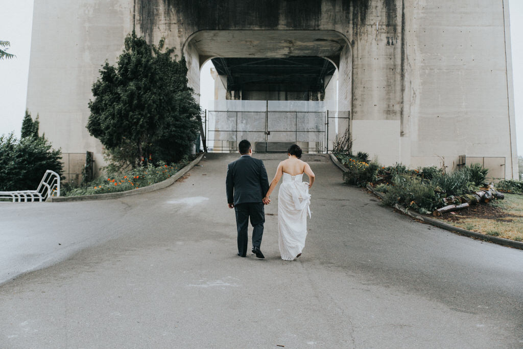 Bride and groom wedding portraits under bridge