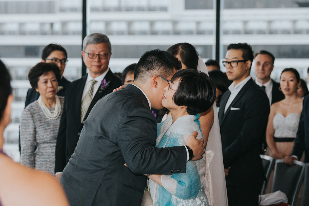 Wedding Ceremony Vancouver Convention Centre Groom hugging mother of the bride
