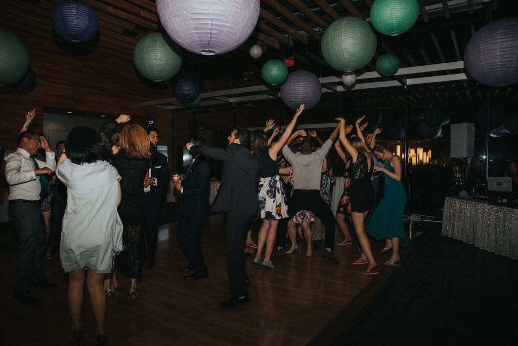 Wedding guests dancing on dancefloor
