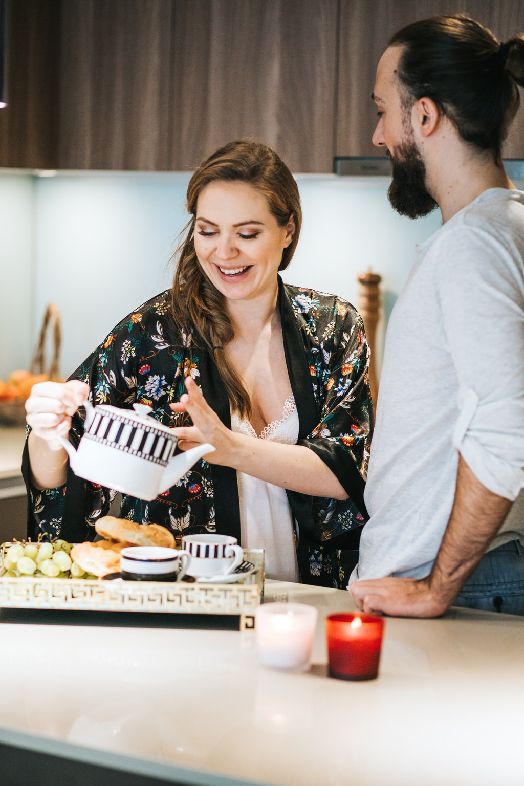 Husband With Pregnant Wife in kitchen
