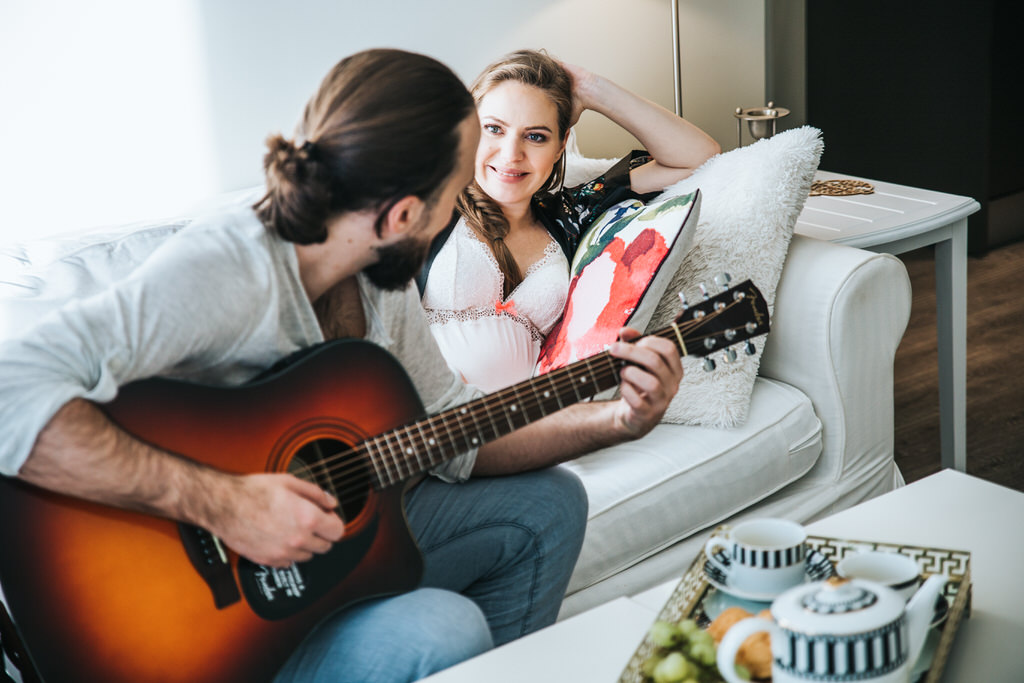Calgary Maternity Photographer Husband Playing Guitar to Pregnant Wife
